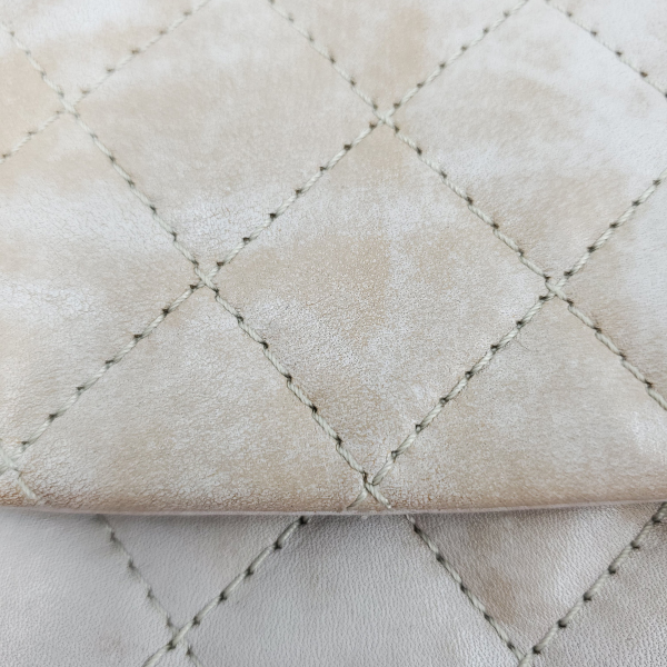 Close up details of pre-owned Chanel Icing Marble Aged Leather Flap Bag.