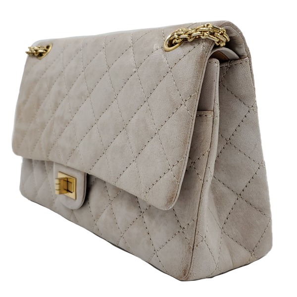 Side view of pre-owned Chanel Icing Marble Aged Leather Flap Bag, with gold tone hardware.