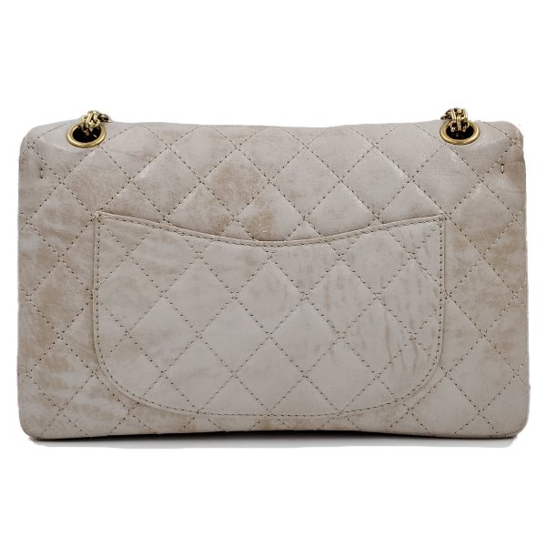 Back view of pre-owned Chanel Icing Marble Aged Leather Flap Bag, with gold tone hardware.