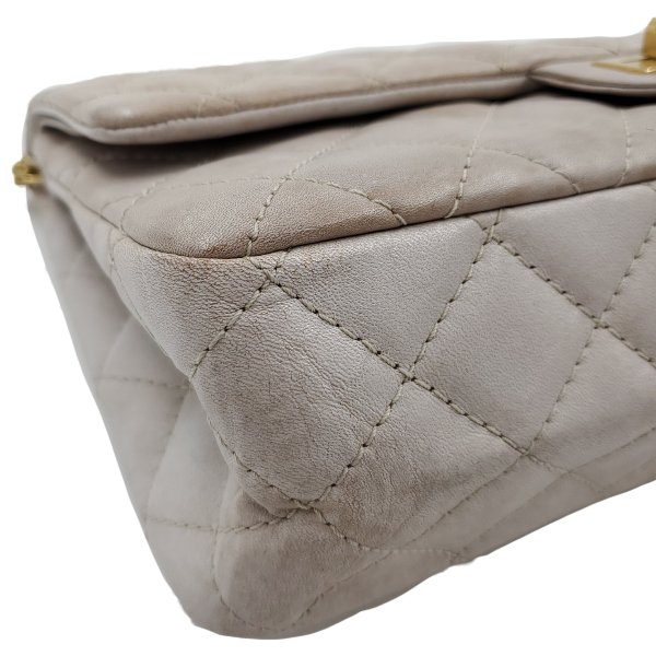 Underside of pre-owned Chanel Icing Marble Aged Leather Flap Bag.