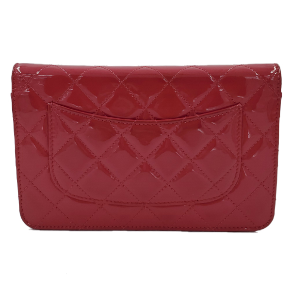 Back view of pre-owned Chanel Pink Quilted Patent Flap Wallet on Chain, with silver hardware.