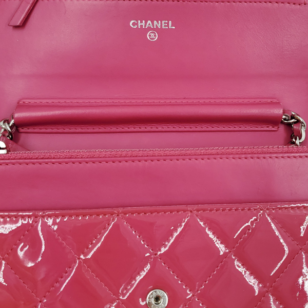 Flap and interior of pre-owned Chanel Pink Quilted Patent Flap Wallet on Chain.