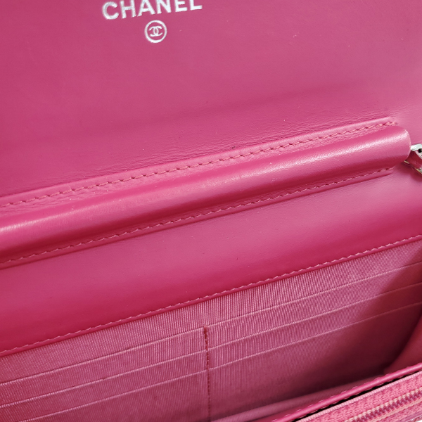 Interior of pre-owned Chanel Pink Quilted Patent Flap Wallet on Chain.