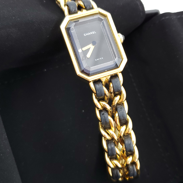 Close up of watch face of pre-owned Chanel Première Gold Plated Women's Wristwatch.