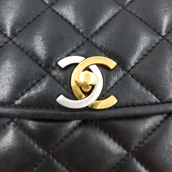 Close up lock of pre-owned Chanel Semi-circle Black Quilted Lambskin Leather Paris Limited Edition Shoulder Bag.