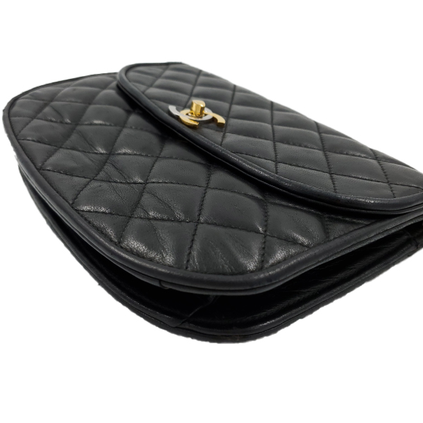 Side view of pre-owned Chanel Semi-circle Black Quilted Lambskin Leather Paris Limited Edition Shoulder Bag.