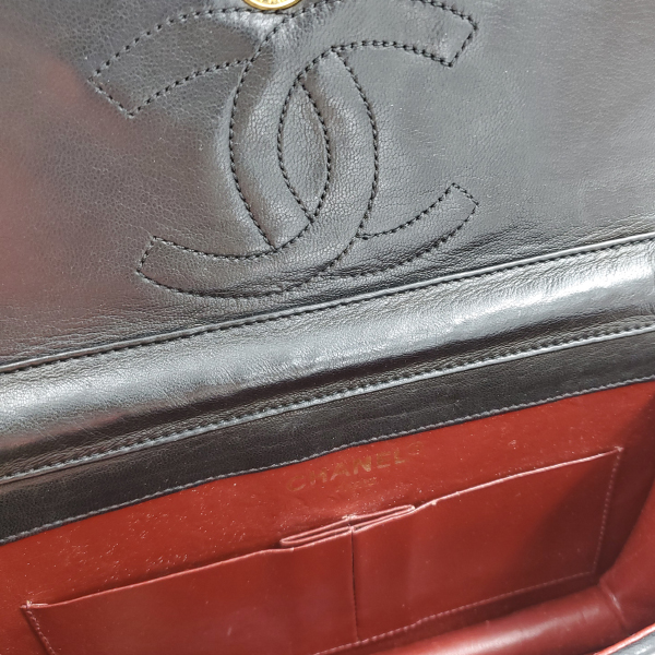 Interior of pre-owned Chanel Semi-circle Black Quilted Lambskin Leather Paris Limited Edition Shoulder Bag.