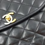 Close up details of pre-owned Chanel Semi-circle Black Quilted Lambskin Leather Paris Limited Edition Shoulder Bag.