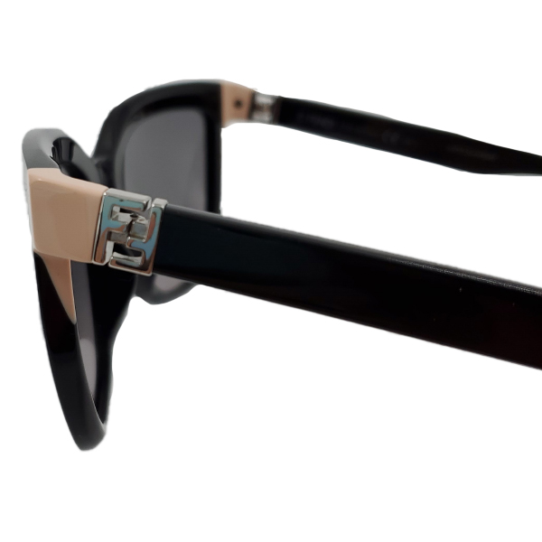Close up of details of pre-owned Fendi Sunglasses in black, with pink details.
