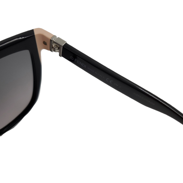 Close up of details of pre-owned Fendi Sunglasses in black.