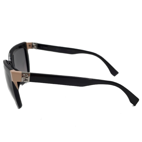 Side view of pre-owned Fendi Sunglasses in black, with pink details.