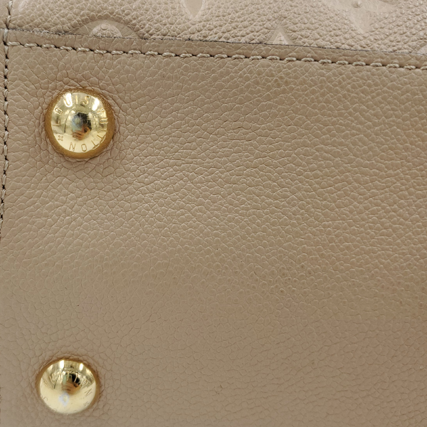 Close up on underside of pre-owned Louis Vuitton Empreinte Trocadero Satchel.